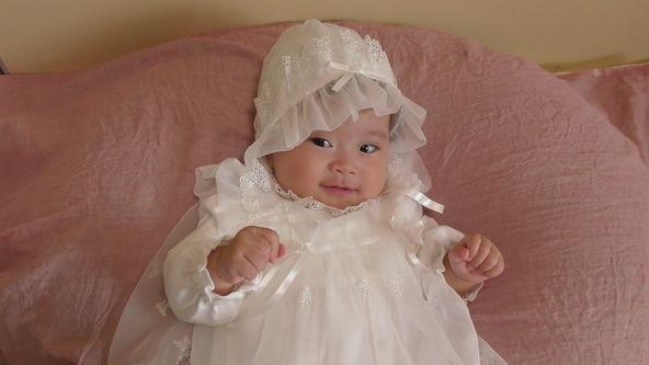da9a656de Cute Baby Model Wearing White Baby Dress