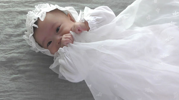 Cute Baby Model Wearing White Baby Dress, Bashful Smile
