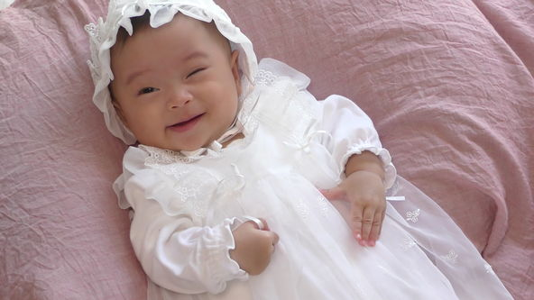 Cute Baby Model Wearing White Baby Dress, Just a moment a wink